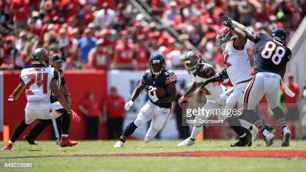 Chicago Bears running back Tarik Cohen looks to evade three opponents after his reception during an NFL football game between the Chicago Bears and...