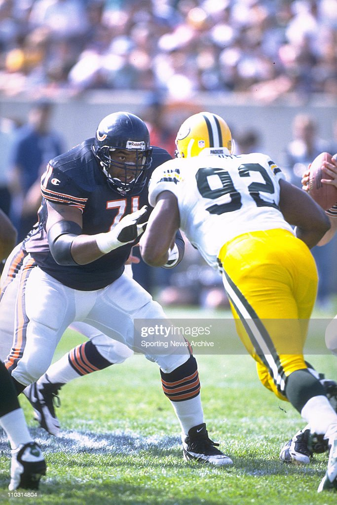 Chicago Bears tackle James ''Big Cat'' Williams blocking Green Bay Packers defensive end Reggie White during a game on October 6 1996 in Chicago...