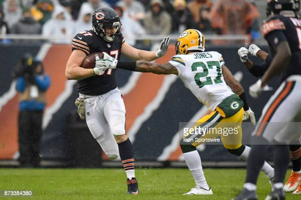 Chicago Bears tight end Adam Shaheen battles with Green Bay Packers safety Josh Jones during an NFL football game between the Green Bay Packers and...