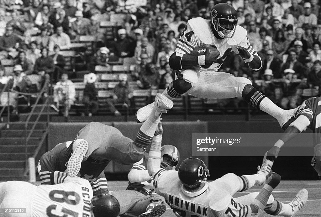 Chicago Bears' <a gi-track='captionPersonalityLinkClicked' href=/galleries/search?phrase=Walter+Payton&family=editorial&specificpeople=216517 ng-click='$event.stopPropagation()'>Walter Payton</a> (#34) hurdles over fallen teammate Gary Hrivnak (#72) as he returns the kickoff in the first quarter. Payton took the kickoff two yards deep in the endzone and returned 24 yards to the 22 yard line.
