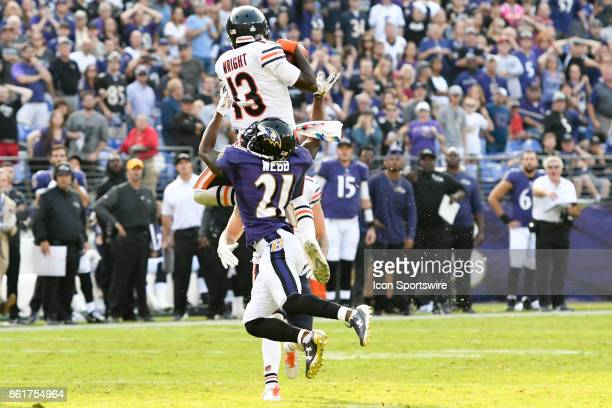 Chicago Bears wide receiver Kendall Wright goes high in the air to pull down a pass in the overtime against Baltimore Ravens free safety Lardarius...