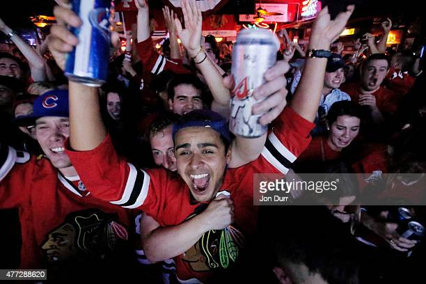 Chicago Blackhawk fans celebrate a goal during Game Six of the NHL 2015 Stanley Cup Final at Sluggers World Class Sports Bar on June 15 2015 in...