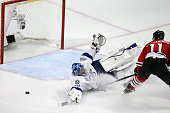 Chicago Blackhawks center Andrew Desjardins takes a shot on Tampa Bay Lightning goaltender Ben Bishop during the second period of Game 6 of the...