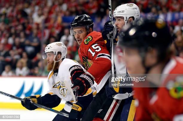 Chicago Blackhawks center Artem Anisimov battles with Nashville Predators center Mike Fisher and Nashville Predators defenseman Ryan Ellis in the...