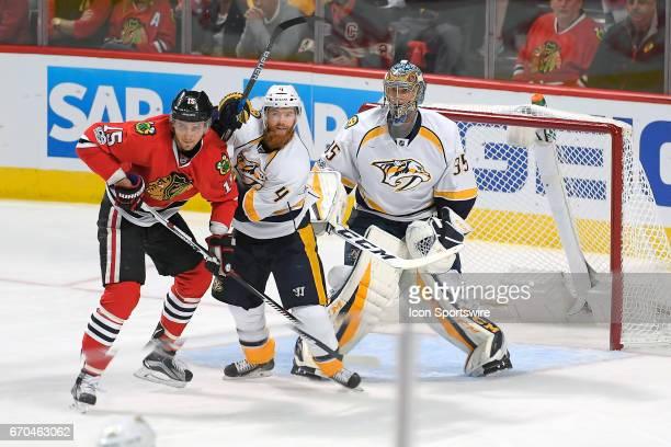 Chicago Blackhawks center Artem Anisimov battles with Nashville Predators defenseman Ryan Ellis and Nashville Predators goalie Pekka Rinne in the...