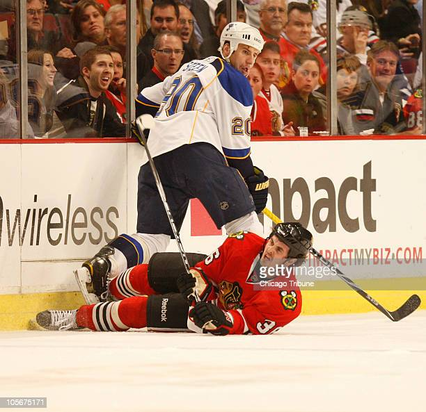 Chicago Blackhawks center Dave Bolland hits the ice while defending against St Louis Blues center Alexander Steen during the first period at the...