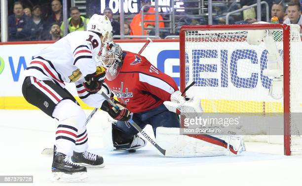 Chicago Blackhawks center Jonathan Toews squeezes the puck under the skate of Washington Capitals goalie Braden Holtby for the second Blackhawks goal...