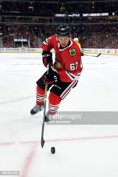 Chicago Blackhawks center Tanner Kero controls the puck during a game between the Chicago Blackhawks and the Nashville Predators on October 14 at the...