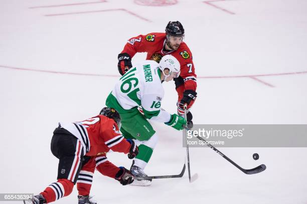 Chicago Blackhawks Defenceman Brent Seabrook attempts to stop Toronto Maple Leafs Right Wing Mitch Marner during the NHL regular season game between...