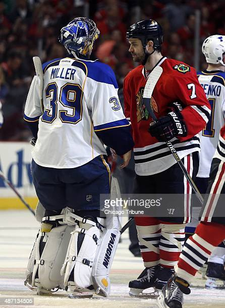 Chicago Blackhawks defenseman Brent Seabrook greets St Louis Blues goalie Ryan Miller at end of the Blackhawks' 51 seriesclinching win in Game 6 of...