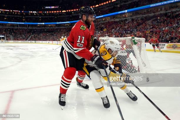 Chicago Blackhawks defenseman Cody Franson battles with Nashville Predators left wing Pontus Aberg during a game between the Chicago Blackhawks and...