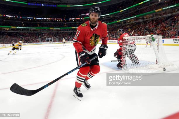 Chicago Blackhawks defenseman Cody Franson chases a loose puck during a game between the Chicago Blackhawks and the Nashville Predators on October 14...