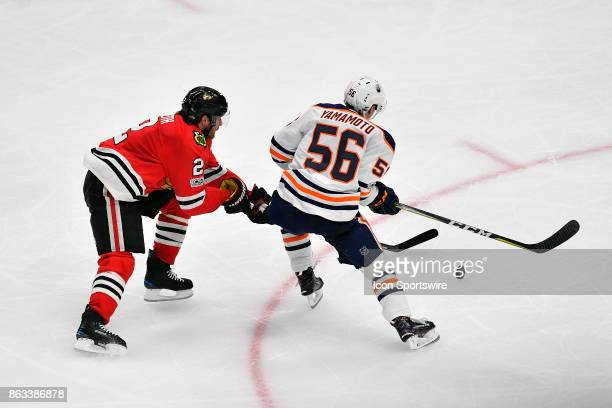 Chicago Blackhawks defenseman Duncan Keith knocks the puck away from Edmonton Oilers right wing Kailer Yamamoto during the match between the Edmonton...
