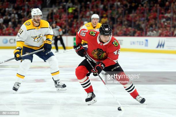 Chicago Blackhawks defenseman Gustav Forsling controls the puck during a game between the Chicago Blackhawks and the Nashville Predators on October...