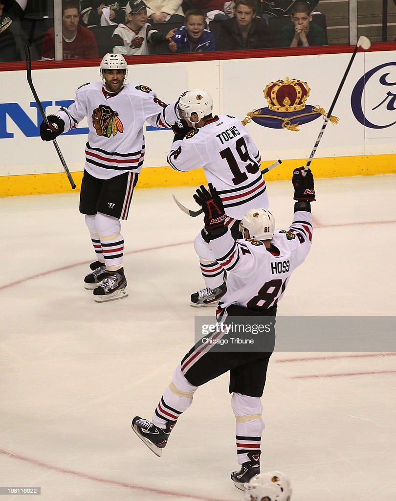 Chicago Blackhawks defenseman Johnny Oduya (27) celebrates after scoring a first period goal against the Minnesota Wild during Game 3 of the NHL Western Conference playoffs at the Xcel Energy Center in St. Paul, Minnesota, Sunday, May 5, 2013.