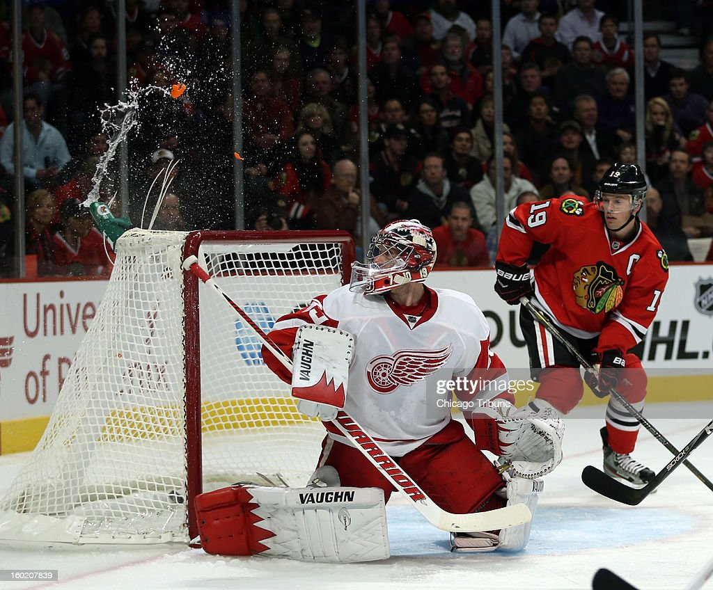 Chicago Blackhawks' Duncan Keith's goal breaks Detroit Red Wings' goalie Jimmy Howard's water bottle during 1st-period action at the United Center in Chicago, Illinois, Sunday, January 27, 2013.