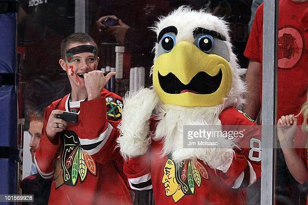Chicago Blackhawks fan points to the Chicago Blackhawks mascot while the Blackhawks take on the Philadelphia Flyers in Game Two of the 2010 NHL...