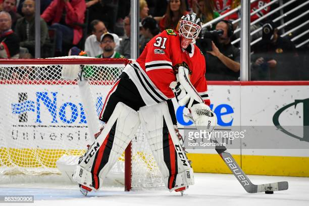 Chicago Blackhawks goalie Anton Forsberg looks to pass the puck during the match between the Edmonton Oilers and the Chicago Blackhawks on October 19...