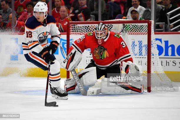 Chicago Blackhawks goalie Anton Forsberg watches Edmonton Oilers center Ryan Strome pass the puck during the match between the Edmonton Oilers and...