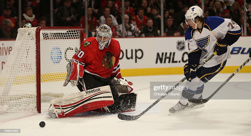 Chicago Blackhawks goalie Corey Crawford (50) blocks the puck away in front of the St. Louis Blues' T.J. Oshie (74) in the second period at the United Center in Chicago, Illinois, on Tuesday, January 22, 2013.