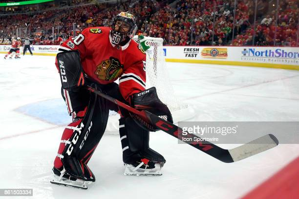 Chicago Blackhawks goalie Corey Crawford chases a loose puck during a game between the Chicago Blackhawks and the Nashville Predators on October 14...