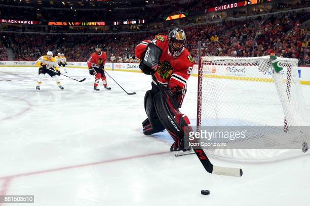 Chicago Blackhawks goalie Corey Crawford clears the puck during a game between the Chicago Blackhawks and the Nashville Predators on October 14 at...
