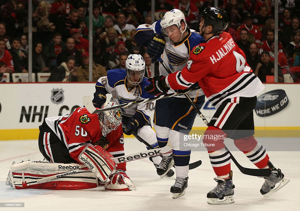 Chicago Blackhawks goalie Corey Crawford (50) covers the puck in the second period against the St. Louis Blues at the United Center in Chicago, Illinois, on Tuesday, January 22, 2013.