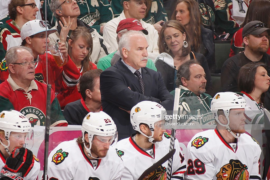 Chicago Blackhawks Head Coach Joel Quenneville watches from behind the bench against the Minnesota Wild during Game Three of the Second Round of the 2014 Stanley Cup Playoffs on May 6, 2014 at the Xcel Energy Center in St. Paul, Minnesota.