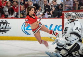 Chicago Blackhawks IceCrew girl slips next to goalie Jonathan Quick of the Los Angeles Kings in Game Two of the Western Conference Final during the...