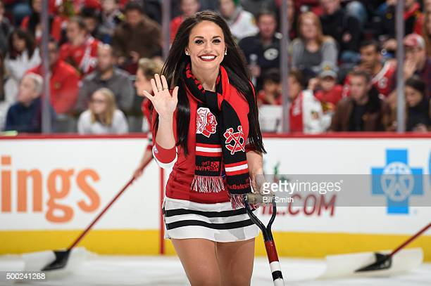 Chicago Blackhawks icecrew girl waves during the NHL game between the Chicago Blackhawks and the Winnipeg Jets at the United Center on December 6...