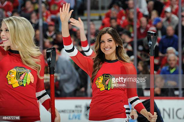 Chicago Blackhawks icecrew girl waves in the first period of the NHL game between the Chicago Blackhawks and the Anaheim Ducks at the United Center...