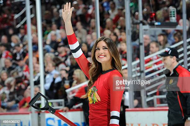 Chicago Blackhawks icecrew girl waves to the crowd in the first period of the NHL game against the Los Angeles Kings at the United Center on November...