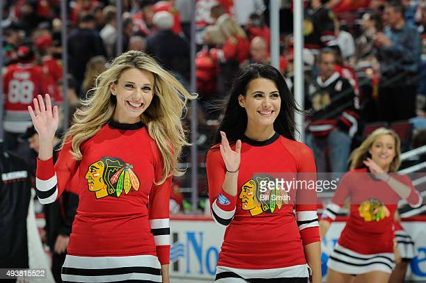 Chicago Blackhawks icecrew girls wave to the crowd in the first period of the NHL game between the Chicago Blackhawks and the Florida Panthers at the...