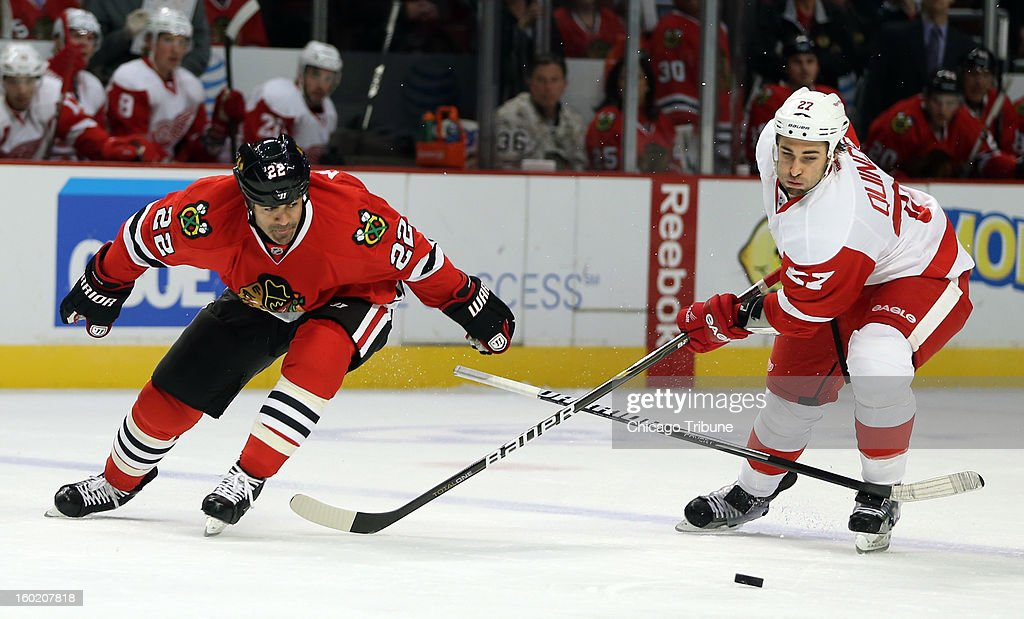 Chicago Blackhawks' Jamal Mayers has his stick knocked from his hand by Detroit Red Wings' Kyle Quincey during 1st-period action at the United Center in Chicago, Illinois, Sunday, January 27, 2013.