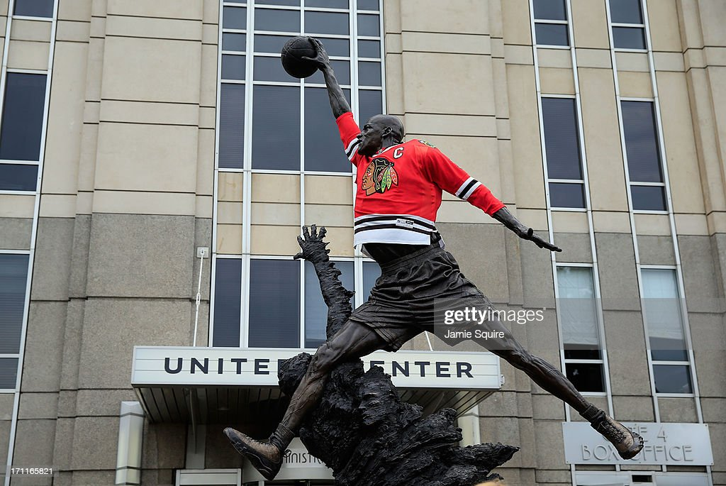 Chicago Blackhawks jersey is seen on the statue of former Chicago Bull and Basketball Hall of Famer Michael Jordan prior to the Blackhawks hosting...