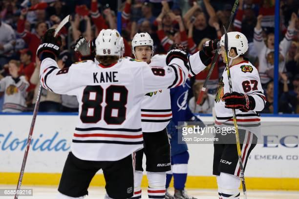 Chicago Blackhawks left wing Artemi Panarin celebrates with Chicago Blackhawks center Tanner Kero and Chicago Blackhawks right wing Patrick Kane...