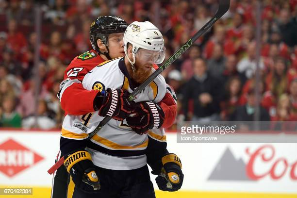 Chicago Blackhawks left wing Artemi Panarin holds onto Nashville Predators defenseman Ryan Ellis after a small fight between the players broke out in...