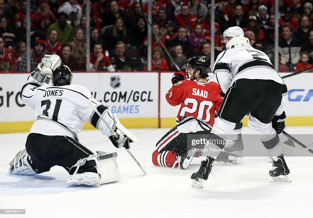 Chicago Blackhawks left wing Brandon Saad (20), scores a goal past Los Angeles Kings goalie Martin Jones (31) during the first period at the United Center in Chicago on Monday, Dec. 30, 2013.