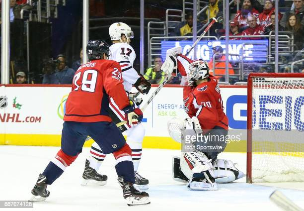 Chicago Blackhawks left wing Lance Bouma watches a shot go past the top of the stick of Washington Capitals goalie Braden Holtby during a NHL game...