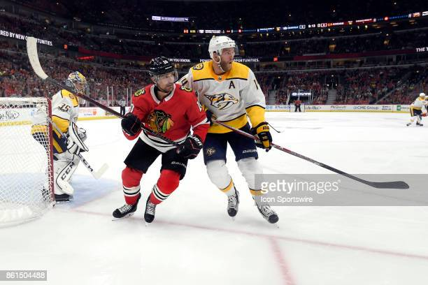 Chicago Blackhawks left wing Patrick Sharp battles with Nashville Predators defenseman Mattias Ekholm during a game between the Chicago Blackhawks...