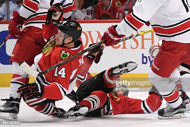 Chicago Blackhawks left wing Richard Panik and Chicago Blackhawks center Tanner Kero trip in the third period during a game between the Carolina...
