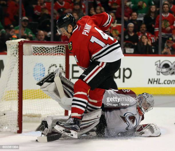 Chicago Blackhawks left wing Richard Panik collides with Colorado Avalanche goalie Jeremy Smith but can't score in the third period on Sunday March...