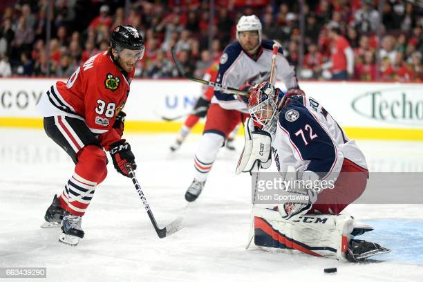 Chicago Blackhawks left wing Ryan Hartman battles with Columbus Blue Jackets goalie Sergei Bobrovsky for a loose puck during the second period of a...