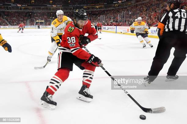 Chicago Blackhawks left wing Ryan Hartman controls the puck during a game between the Chicago Blackhawks and the Nashville Predators on October 14 at...