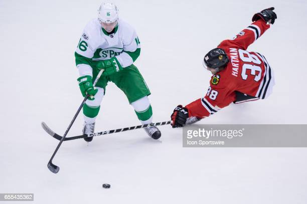 Chicago Blackhawks Left Wing Ryan Hartman ties to take the puck away from Toronto Maple Leafs Right Wing Mitch Marner during the NHL regular season...