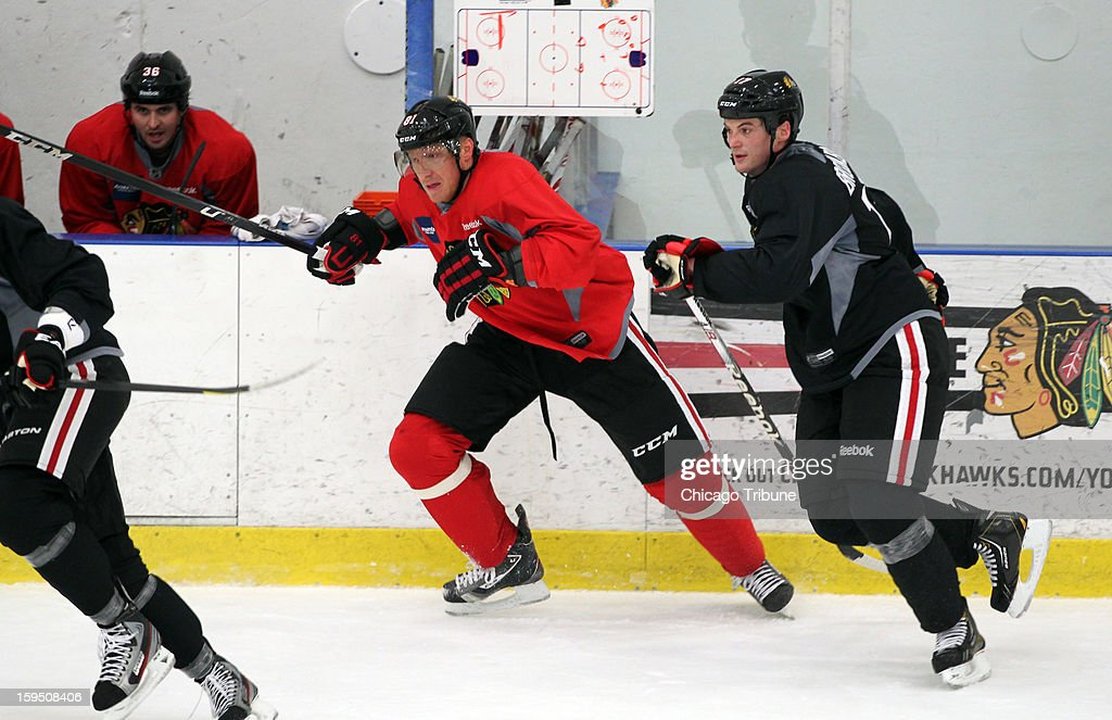 Chicago Blackhawks' Marian Hossa and Sheldon Brookbank run through drills during training camp at Johnny's IceHouse West in Chicago, Illinois on Monday, January 14, 2013.