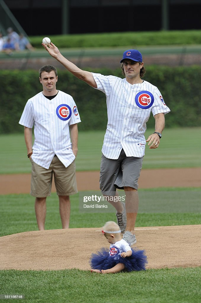 Chicago Blackhawks Patrick Sharp throws out the first pitch with his daughter Madelyn Sharp before the game between the Chicago Cubs and the San Francisco Giants on September 02 2012 at Wrigley Field in Chicago, Illinois.