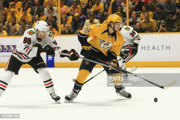 Chicago Blackhawks right wing Patrick Kane challenges Nashville Predators left wing Kevin Fiala for the puck during game three of Round One of the...