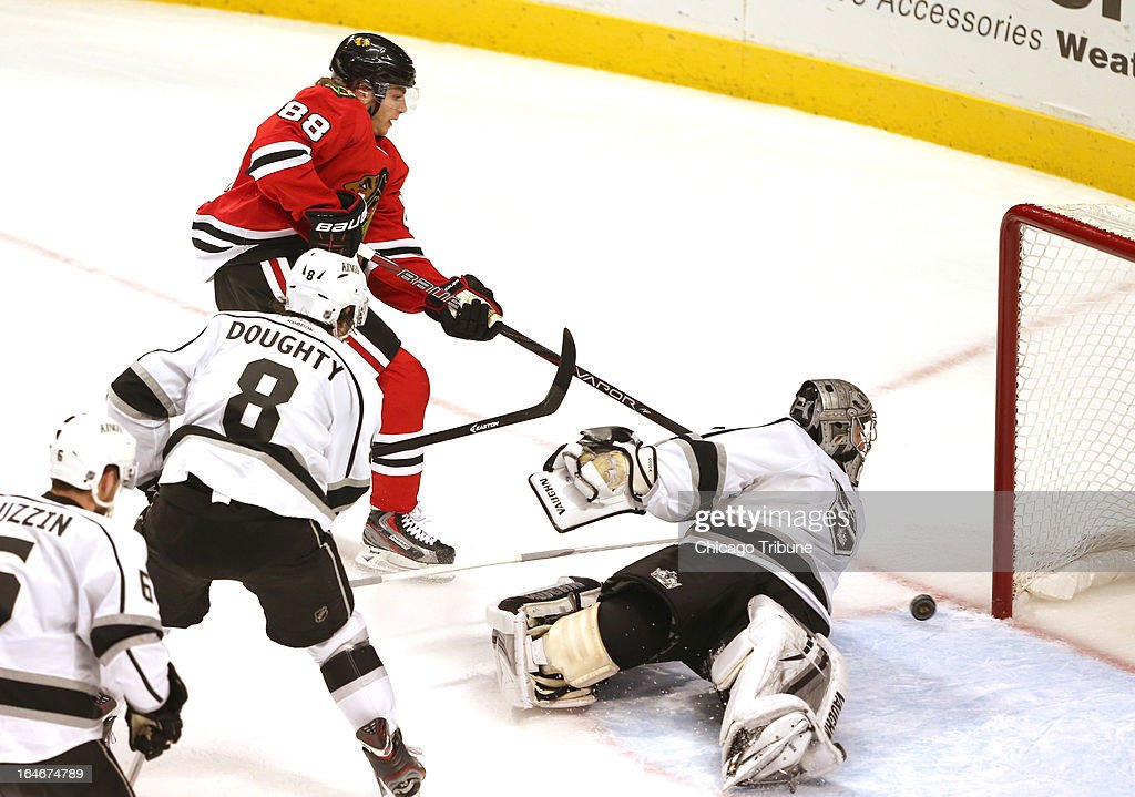 Chicago Blackhawks right wing Patrick Kane (88) slides the puck past Los Angeles Kings goalie Jonathan Quick (32) for a goal during the second period at the United Center in Chicago, Illinois on Monday, March 25, 2013.