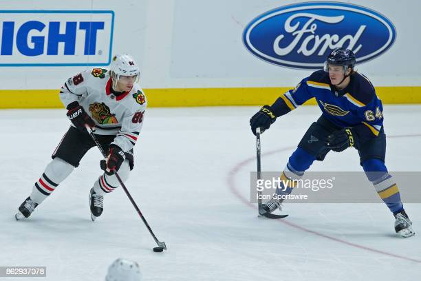 Chicago Blackhawks right wing Patrick Kane stakes against St Louis Blues left wing Sammy Blais during a NHL hockey game between the St Louis Blues...